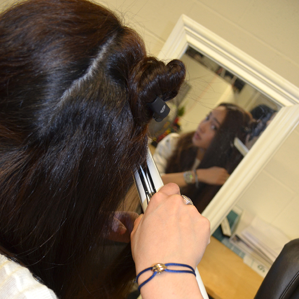 straightening iron in use